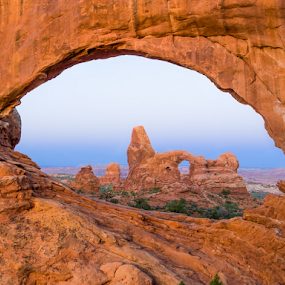 Turret Arch through North Window Arch by Kenneth Keifer - Landscapes Caves & Formations ( north window, arch, colorful, vivid, arid, sandstone, national parks, stone, rock, vibrant, landscape, colorado plateau, turret, geology, scrub, sky, nature, varnish, slick rock, southwest, dramatic, pinnacle, geological, sightseeing, hole, moab, orange, dry, desert, purple, the west, horizon, windows, scenic, morning, daybreak, red, dawn, arches national park, utah, arches, sunrise, four corners )