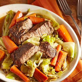 Slow-Cooked Beef with Carrots and Cabbage.