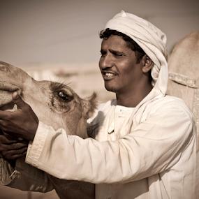 I Care About You by Viktoryia Vinnikava - People Street & Candids ( camels racing, camel, desert, uae, emotions, care, 2012, candid, men, smile )