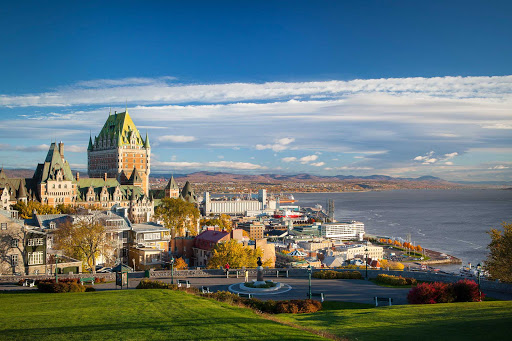 The Fairmont Le Chateau Frontenac towers over neighboring buildings in Quebec City.  It was designated a National Historic Site of Canada in 1980.