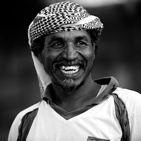 How much is this laugh worth? by Marzook Mohd - Black & White Portraits & People