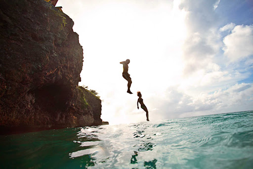 Curacao-cliff-jumping - For a rush of adrenaline, try cliff jumping into the crystal clear waters at Playa  Forti, Curacao.