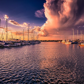 Stormy Skies by Alex Bogdan - Landscapes Sunsets & Sunrises ( clouds, sky, ripples, boats, reflections, marina, storm, light, rays, panorama, colours )