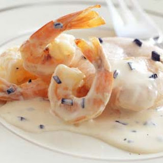 Poached Salmon with Truffles and Shrimp in Cream Sauce.