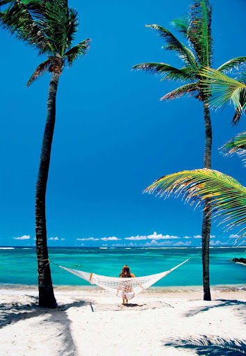 Unplug and pull up a hammock during a day on a tropical beach during your Windstar cruise.