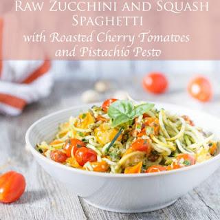 Raw Zucchini and Squash Spaghetti with Roasted Cherry Tomatoes and Pistachio Pesto.