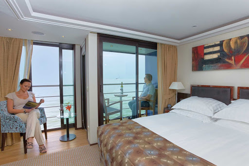 AmaBella-Stateroom-Twin-Balcony - Relax and enjoy the sights of your European cruise from the comfort of a twin balcony suite aboard AmaBella.