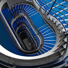 Blue staircase by Péter Mocsonoky - Buildings & Architecture Architectural Detail ( interior, climb, way, architecture, geometric, business, iterate, modern, level, stairs, stairway, levels, dark, endless, perspective, deep, abstract, office, building, stair, shape, spiral, steps, up, urban, blue, staircase, inside, background, view, high, down, design, step,  )