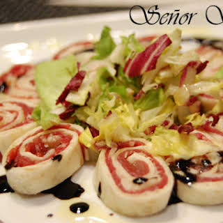 Carpaccio and Parmesan Cheese Rolls with Balsamic Vinegar.