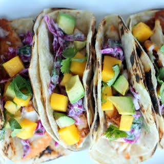 Grilled Chili-Lime Fish Tacos with Sour Cream Cabbage Slaw + Mango & Avocado.