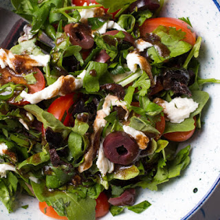 Mixed Herbs Salad With Olives, Tomatoes, and Fresh Mozzarella.