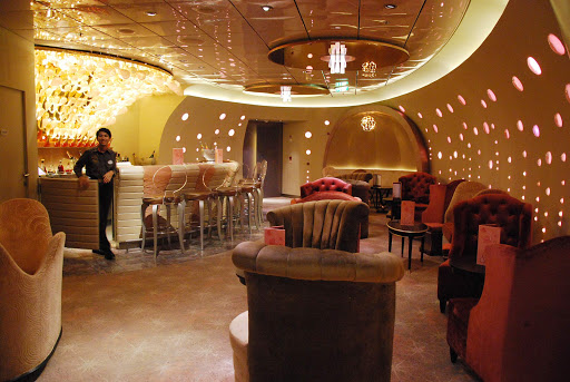 Disney-Dream-lounge - A waiter staffs an entertainment lounge bar aboard Disney Dream.