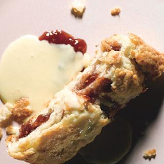 Rhubarb and Raspberry Jam Roly-Poly with Vanilla Custard Sauce.