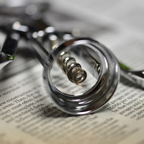 Time to relax. by Viana Santoni-Oliver - Food & Drink Alcohol & Drinks ( wine, macro, metal, tool, corkscrew, implement, close-up )