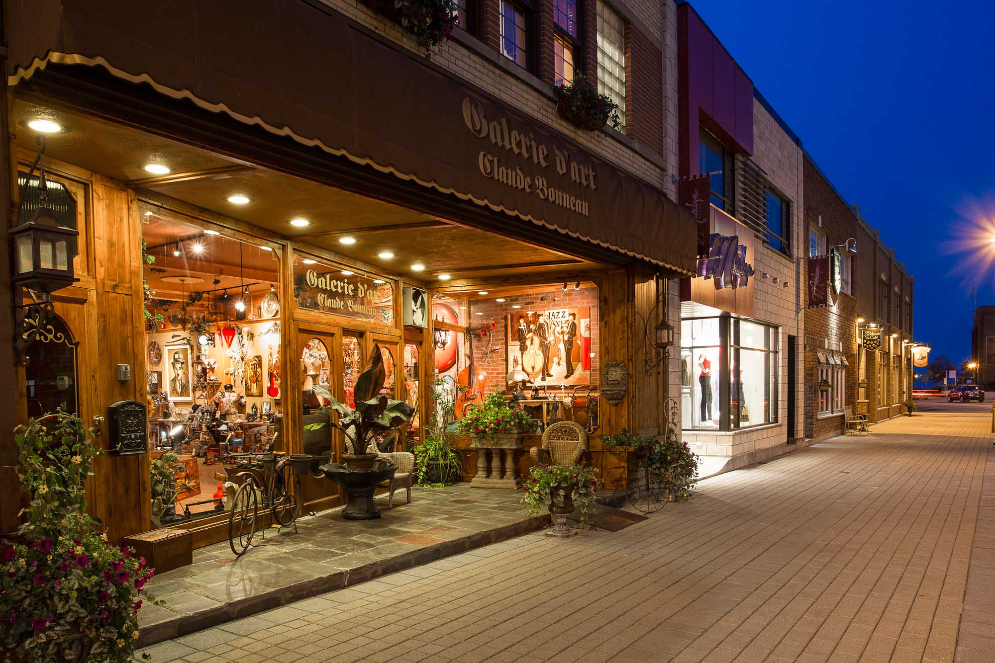 An art gallery and shops in the city center of Baie-Comeau, a town 260 miles northeast of Quebec City in the Cote-Nord region of Quebec, Canada.