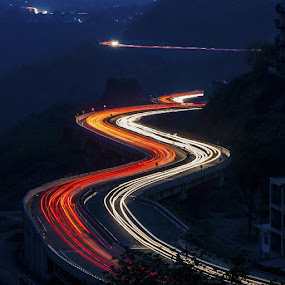 Light TrailsI've always loved capturing long exposures with vehicular light trails being the favorite. These light trails were captured along the Himalayan Expressway. The highway curves are wonderfully accentuated by the front and tail lights of the moving vehicles. Shot taken at 30 sec exposure by Havneet Singh - Landscapes Travel ( photography, nikon, landscape, longexposure, night, bluehour, shutterspeed, himachalpradesh, highway, hills, curves, light, trails )