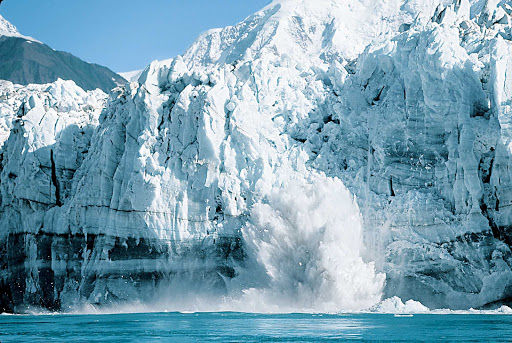 Princess-Cruises-Alaska-ice-calving - Ice calving (where chunks of glacier fall into the water) in Alaska.