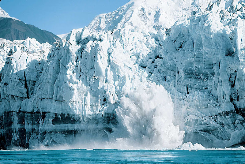 Ice calving (where chunks of glacier fall into the water) in Alaska.