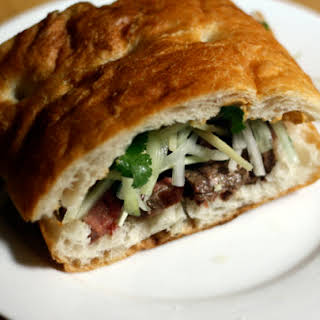 Steak Sandwich with Cucumber, Ginger Salad, and Black Chile Mayonnaise.