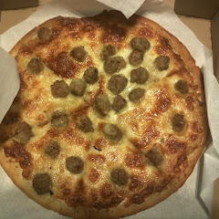Pizza with italian sausage and garlic sauce