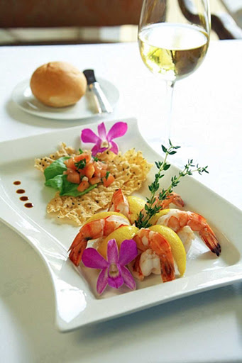cuisine-Anguilla - A shrimp dish with a glass of wine makes for a nice lunch at an Anguilla restaurant.