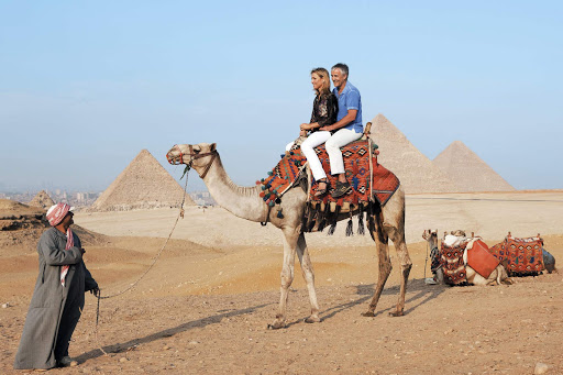 Tour-Giza-Egypt-on-camel - Explore the pyramids of Giza the old-fashioned way on a daylong shore excursion during your vacation in Egypt aboard Uniworld's River Tosca.