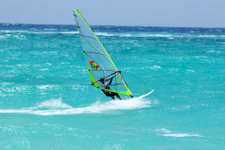 Windsurfing in the waters of Barbados.