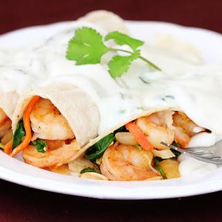 Verde Shrimp Enchiladas With Jalapeno Cream Sauce.
