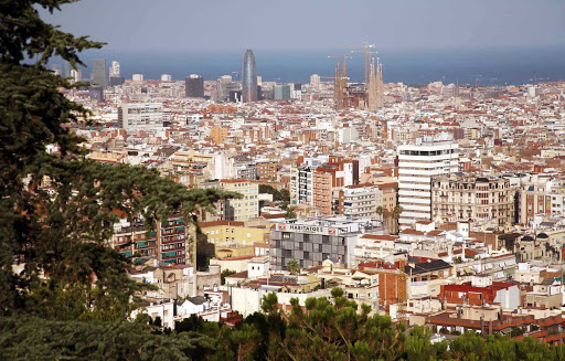 A sweeping view of the Barcelona skyline, with the unfinished Sagrada Família in the distance.