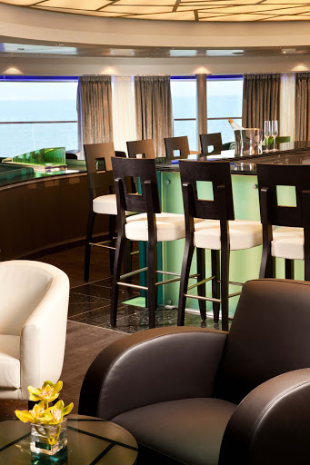 Seabourn_Observation_Bar-4 - Panoramic views greet guests as they gather for early morning risers' coffee and tea in the Observation Bar on Seabourn Odyssey.