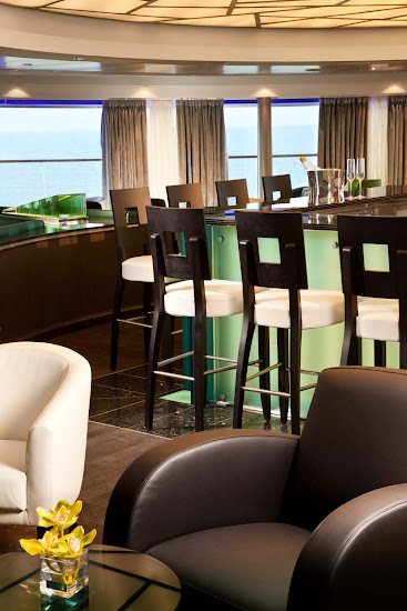 Panoramic views greet guests as they gather for early morning risers' coffee and tea in the Observation Bar on Seabourn Odyssey.