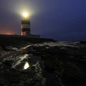 Hope at night. by Jozef Svintek - Landscapes Waterscapes ( reflection, ireland, lighthouse, light, rocks,  )