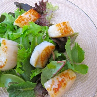 Caramelized Scallops with Baby Greens and Lemon Vinaigrette.