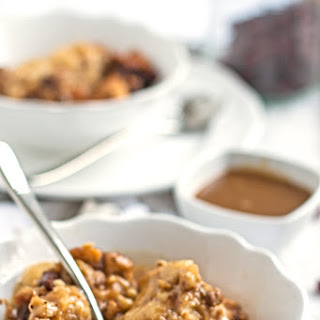 Slow Cooker Cranberry Walnut Bread Pudding with Caramel Sauce.
