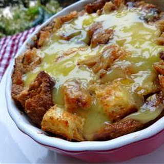 Rum Raisin Bread Pudding with Warm Vanilla Sauce.