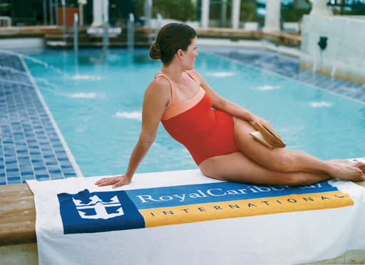 Royal-Caribbean-woman-poolside - Relax at poolside and let your cares slip away during your Royal Caribbean sailing.