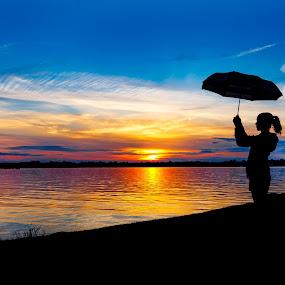 The Girl with the Umbrella by Olga Gerik - Landscapes Sunsets & Sunrises ( sky, girl, sunsets, sunset, umbrella,  )
