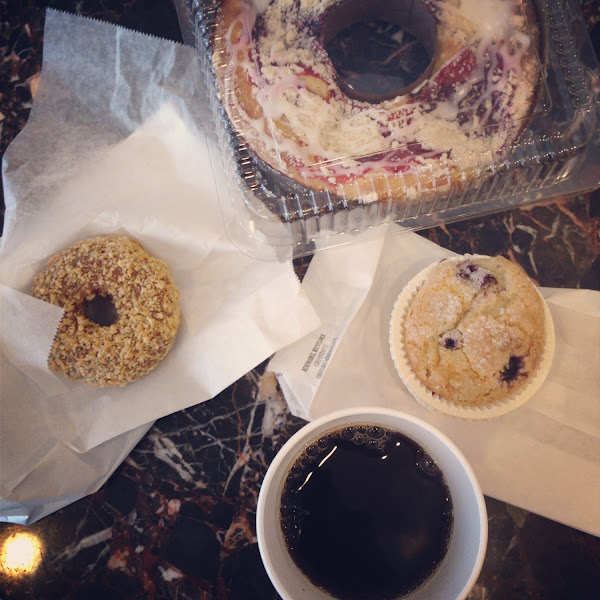 All gluten free baked goodies!  Peanut covered donut, blueberry muffin, and a raspberry ring cake!