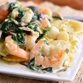 Ravioli with Seafood, Spinach & Mushrooms in Garlic Cream Sauce.