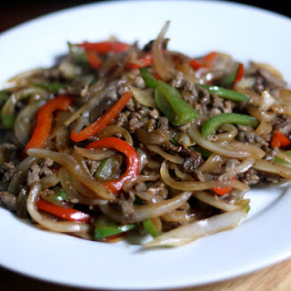 Stir-Fried Beef with Onions and Peppers.
