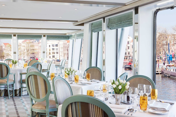 Dine in the elegant restaurant aboard Uniworld's River Duchess while taking in captivating views of passing landscapes during your European river cruise.