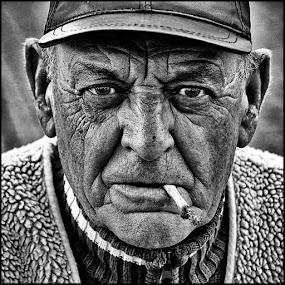Groene Michel by Etienne Chalmet - People Portraits of Men ( black and white, street, men, portrait, smoke,  )