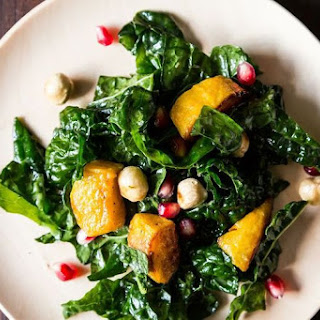 Hearty Kale Salad with Kabocha Squash, Pomegranate Seeds, and Toasted Hazelnuts.