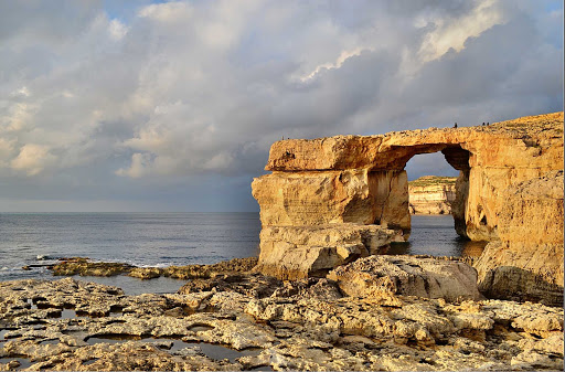 On the island of Gozo in Malta, the Azure Window is a natural arch located near the village of Dwejra.