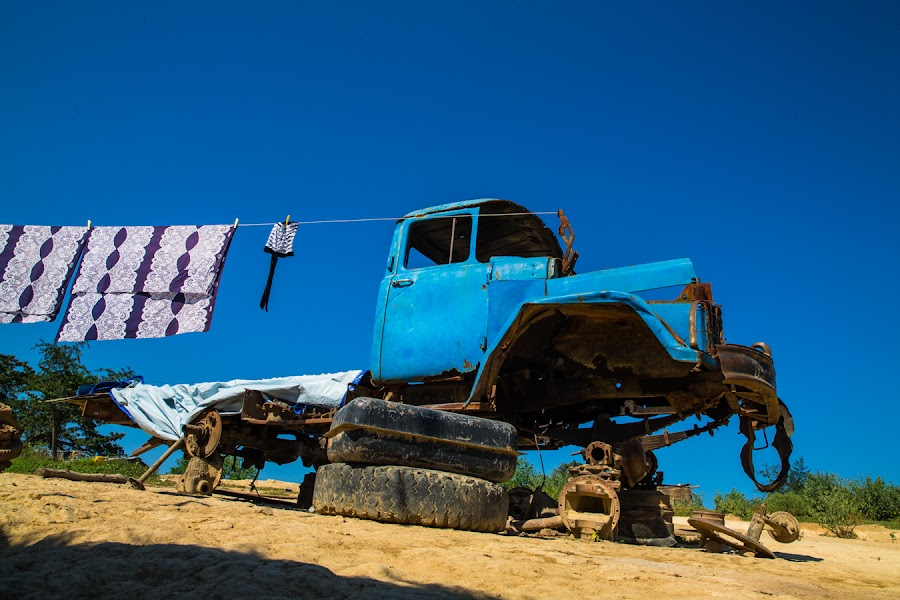 A Perfect Clothesline by Richard Duerksen - Artistic Objects Other Objects ( angola, clothesline, blue truck, derelict, antique, country )