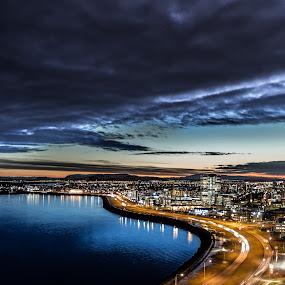 Reykjavik at Dawn by Sigurður Brynjarsson - City,  Street & Park  Night ( shore, car, building, streetlight, street, beautiful, sea, ocean, house, city, iceland, dawn, sky, skyscraper, side, reykjavik, wave, cloud, fast, light )