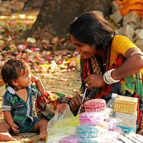 Joy in Small Things by Seema Nair - People Street & Candids ( child, mother, mother and child, street, poor, people, street photography, Travel, People, Lifestyle, Culture )