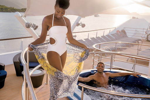Relax with a luxurious whirlpool on the sundeck of Tere Moana during your sailing to the Caribbean, Mediterranean or South Pacific.