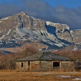Old Man of the Hills by Don Evjen - Landscapes Mountains & Hills ( clouds, cabin, mountains, cliffs, montana, snow, rustic )