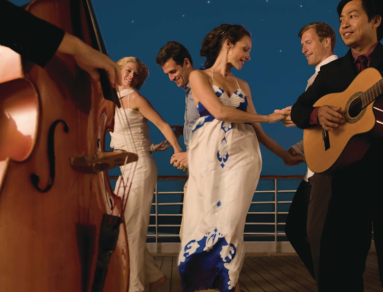 Sway to the music and feel the sea breeze while dancing on the deck of Seabourn Odyssey.